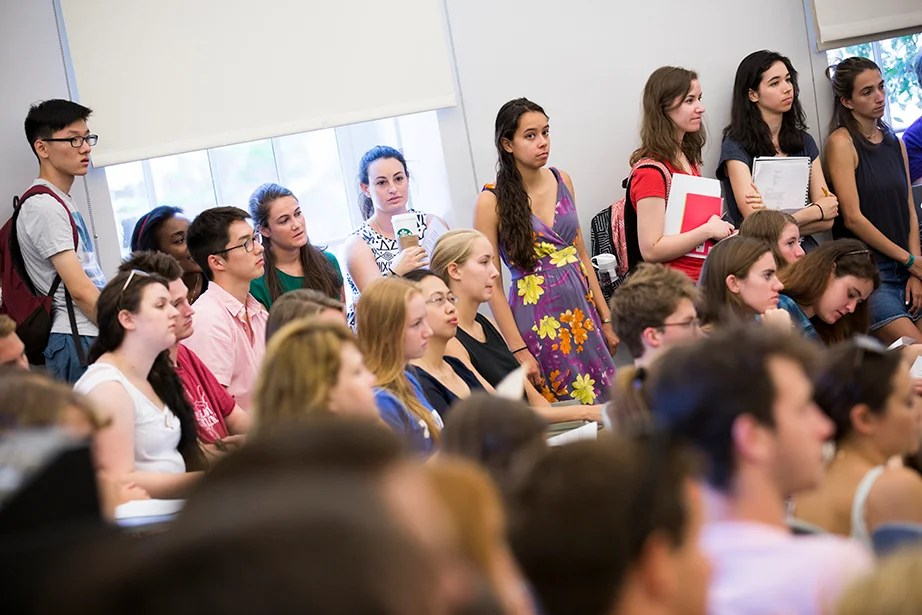 Students crowd into Wood's classroom to hear his introduction. Stephanie Mitchell/Harvard Staff Photographer