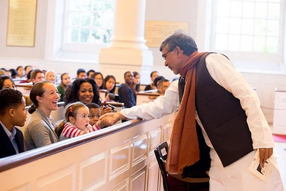 Indian children' rights activist, Kailish Satyarthi greets children in the audience before he received the Humanitarian of the Year Award from the Harvard Foundation. Rose Lincoln/Harvard Staff Photographer