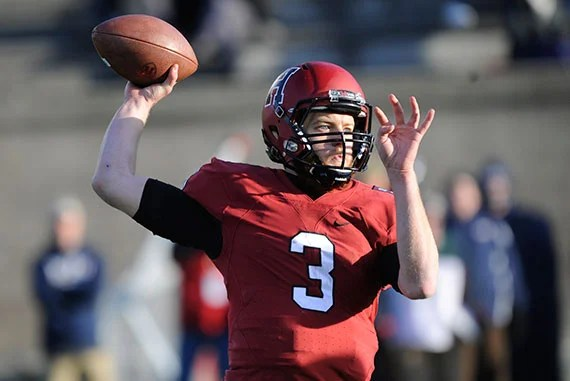Harvard football v. Penn. Facing a late afternoon sun, QB Scott Hosch '16 gets set to pass. Hosch completed 20-of-30 passes for 246 yards and two touchdowns, including 134 to classmate Ben Braunecker '16. Jon Chase/Harvard Staff Photographer