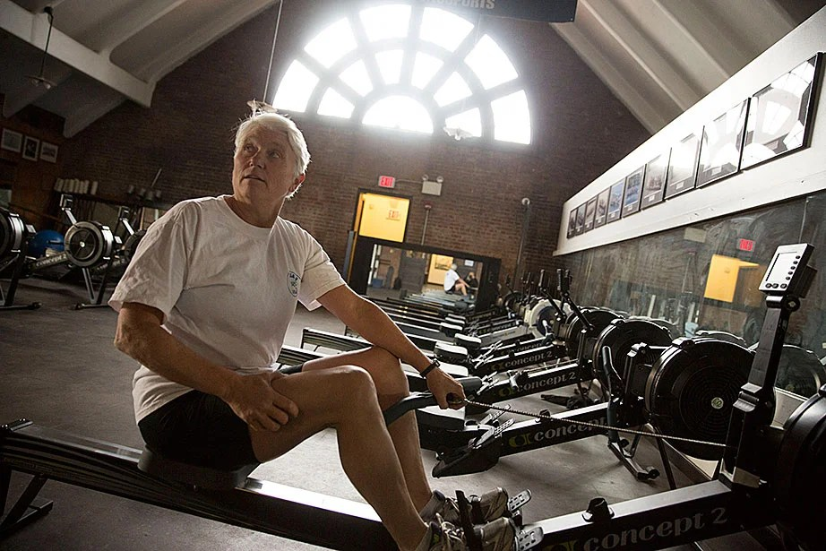 Kathy Keeler, an Olympic gold medalist, volunteer coach with the Radcliffe crew team, and widow of the late Harry Parker (the Thomas Bolles Head Coach for Harvard men's heavyweight crew for 51 seasons), works out on a rowing machine inside Weld Boathouse.