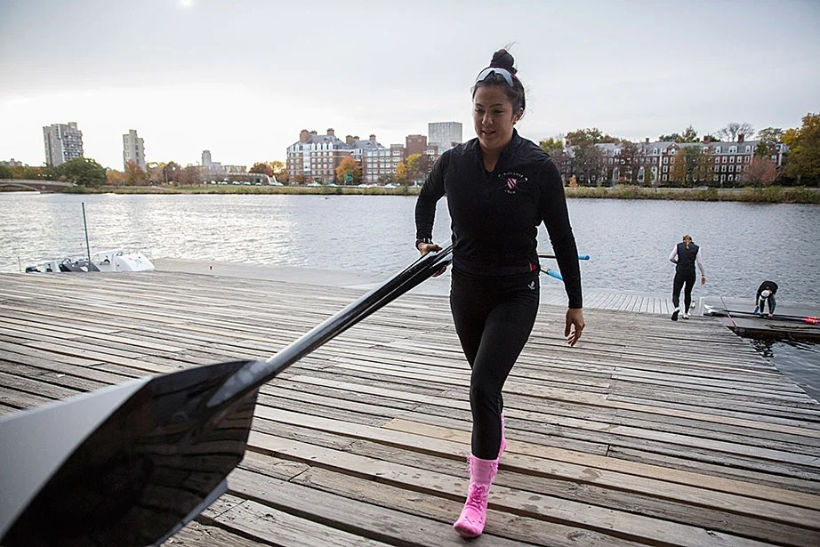 Emily Gaudiani '17 carries oars into Weld Boathouse.