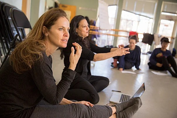 """Amy Brenneman '87 (from left) and Sabrina Peck '84 teach """"Performing Our Experience: Tools for Creating Original Theater"""" as part of the January Arts and Media Seminars sponsored by the Office for the Arts at Harvard."""