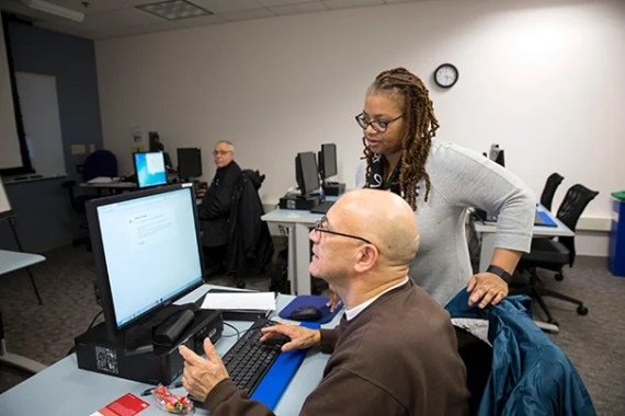 The Harvard University Bridge Program helps entry-level workers at Harvard learn English and computer skills to move up the ladder.Tamara Suttle teaches a basic computer class in Harvard's Education Portal to Abderrazak Abouallala, HRES, (on left) and Oscar Farias HBS Rose Lincoln/Harvard Staff Photographer