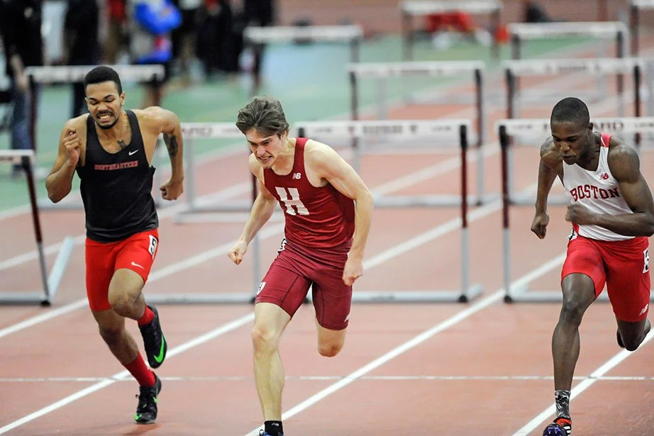 Jay Hebert '18, center, pulls out a victory in the 60-meter hurdles with a career-best time of 8.12 seconds.
