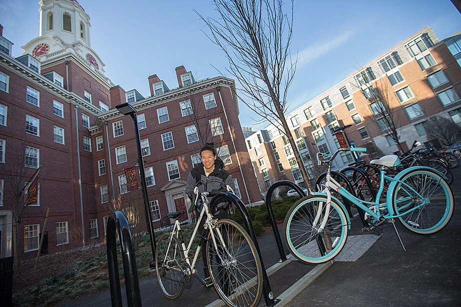 Sally Gee '16 locks up her bike on new bike racks outside of Dunster House. Kris Snibbe/Harvard Staff Photographer