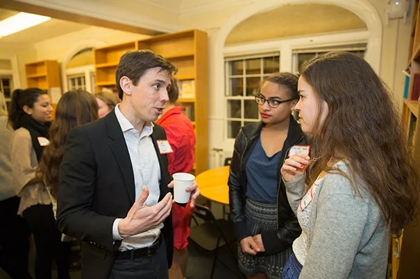 "During the student-faculty dinner, David Elmer shared his story with Sabrina Yates '19 (center) and Sarah Angell '18. ""I came close to going to Quantico and joining the FBI,"" said Elmer, a professor in the Classics Department, recalling a period of uncertainty."