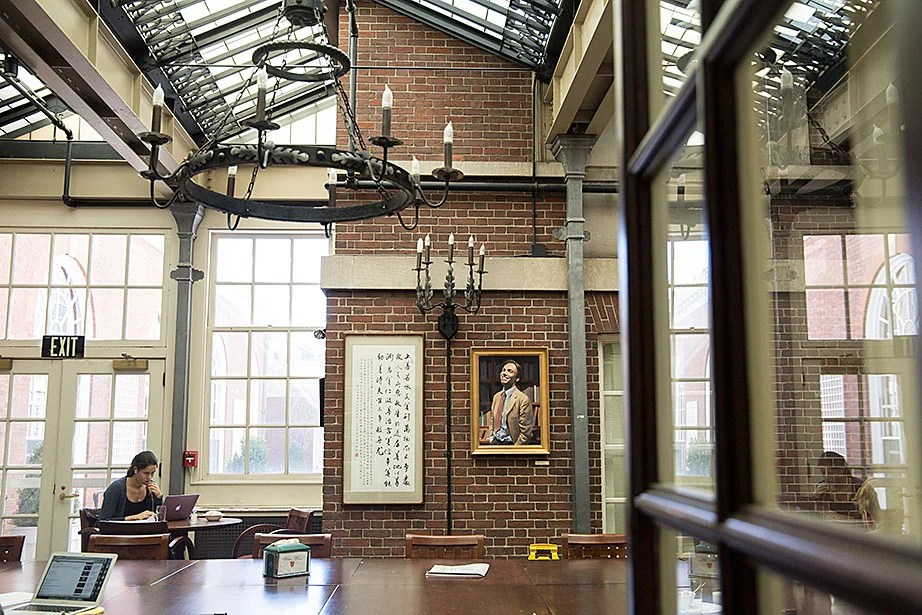 The Adams House dining hall has several adjoining rooms that are also used as dining, socializing, and study spaces. The decor of this room includes a glass ceiling and glass doors that filter in natural light.