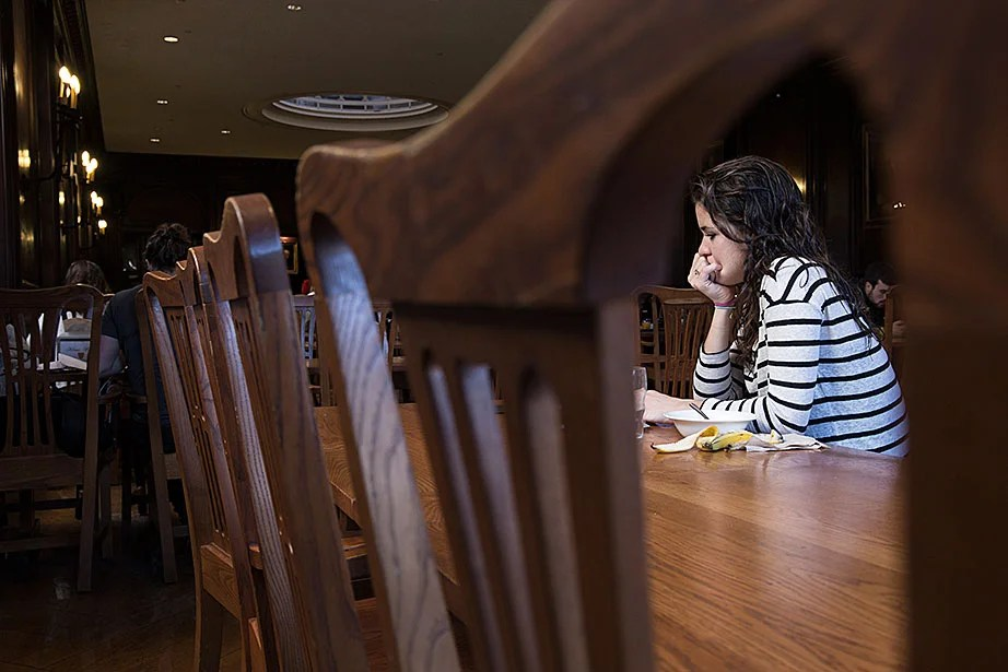 "Gabrielle Sejourne '18 can often be found studying in the Adams House dining hall. ""I like the fact that I can get my work done because it's not too loud in here, but it's not as suffocating as the library could be,"" said Sejourne."