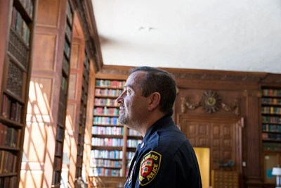 "Christos Hatzopoulos, who will graduate from Harvard Extension School, is a detective with the Harvard University Police Department. ""History was never a dead science for me,"" he said. ""I've been reading history books my whole life for pleasure."""