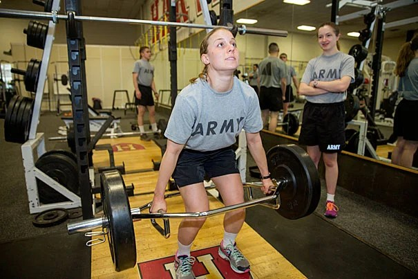 "ROTC Army Cadets Charlotte ""Charley"" Falletta '16 (left) and Alannah O'Brien '19 go through their physical training exercises at the Murr Center. ""We have a drive and we have a passion and we're working toward something that we feel is very, very important,"" Falletta said of her fellow cadets. Kris Snibbe/Harvard Staff Photographer"