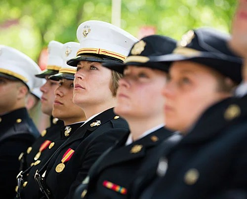 Commissioning officers, including Carolyn Pushaw (center), listen during the ROTC Commissioning Ceremony for the Class of 2016.