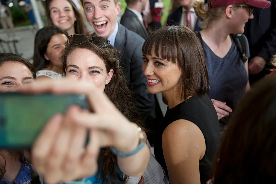 Class Day Exercises featured speaker Rashida Jones '97 (right), who posed for a selfie with students on the stage. Rose Lincoln/Harvard Staff Photographer