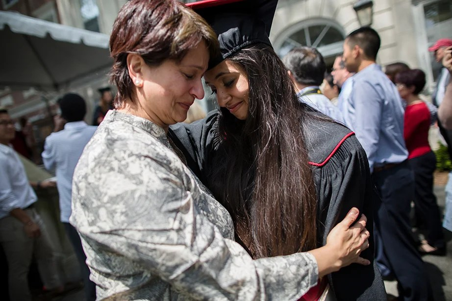Kirin Gupta (right) shares a moment with her mother, Devika, after she receives her diploma. Stephanie Mitchell/Harvard Staff Photographer