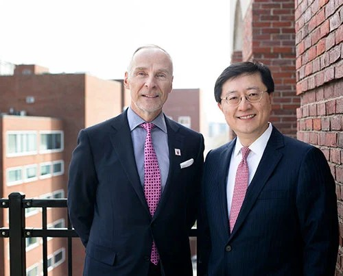 """Martin J. """"Marty"""" Grasso Jr. '78 (left) is the incoming president of the Harvard Alumni Association, taking over the role held by Paul L. Choi '86, J.D. '89."""