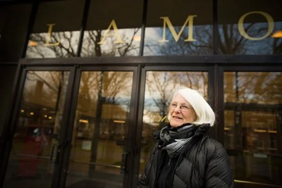 """""""Women were not allowed inside of Lamont,"""" said Frinde Maher, Radcliffe '64, standing in front of the library that had excluded women."""