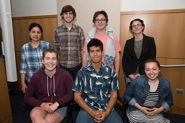 Cambridge Rindge & Latin students (front row, from left) Anna Jackson MacManus, Alex Schulman, and Emma Nour Belabbes with their mentors (back row, from left) Fatma Gomaa, Daniel Utter, Dylan Wainwright, and Aude Picard presented projects developed as part of their marine science internship.
