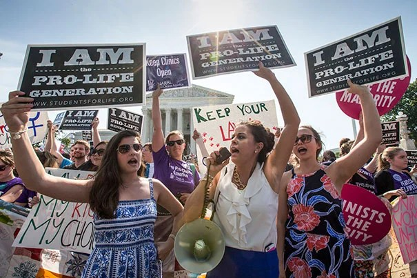 Anti-abortion activists demonstrated in front of the Supreme Court on Monday.