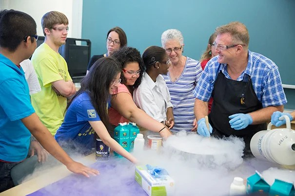 Horace Mann students Walberto Hernandez (from left), Christopher Ancheta, Liu Xiao Ting, Kaysha Hernandez, and Janasia Butler feel the cold vapors sublimating from Daniel Rosenberg's bowl of ice cream base as he freezes it with liquid nitrogen.