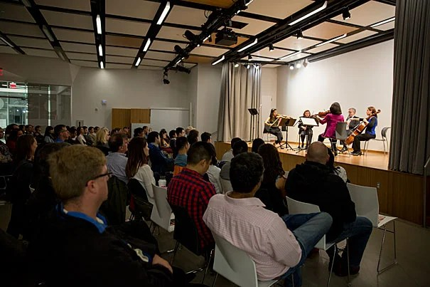 Physician and violinist Lisa Wong (in pink) was among the members of the Longwood Symphony Orchestra who described the connection between music and medicine  during a panel discussion at the Ed Portal.