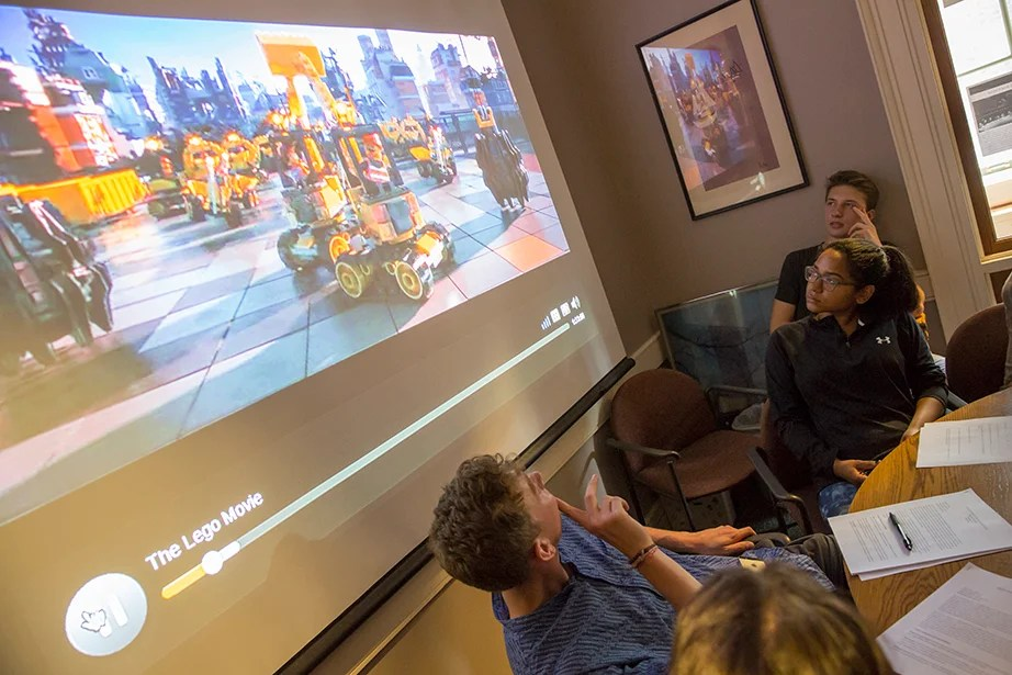 "Students watch a clip from ""The Lego Movie"" during ""American Economic Fictions."" Jon Chase/Harvard Staff Photographer"