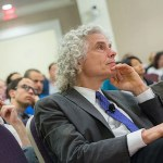 """Steven Pinker, Johnstone Family Professor of Psychology, listens during the symposium """"Behavioral Ethics"""" at the Spangler Auditorium. Pinker took part in a panel discussion with philosophers Joshua Greene and Peter Singer to discuss what society can do to create more ethical behavior."""