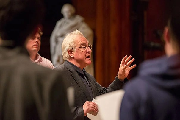 Pulitzer Prize winning composer and Harvard University Class of 1980 alumnus Paul Moravec discusses his new piece commissioned by the Harvard Glee Club and Radcliffe Choral Group at their rehearsal for the upcoming Holiday Concert Nov. 30 in Sanders Theatre. Photo by Sarah Silbiger