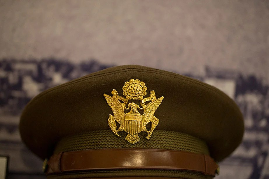 "A U.S. Army dress cap from the collection of Lieutenant Colonel Norman T. Newton, a Harvard landscape architecture professor. Newton spent three years traveling through Italy as part of the Monuments, Fine Arts, and Archives program (""The Monuments Men"") that worked to survey, protect, and recover cultural artifacts in areas affected by World War II."