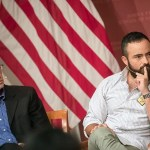 """Dan Balz (left) and Carlos Rojas listen during """"DACA: What's next"""" at the JFK Jr. Forum. """"[U]ndocumented youth are no longer willing to throw our parents, future immigrants, and people who live on the border under the bus,"""" said Rojas."""