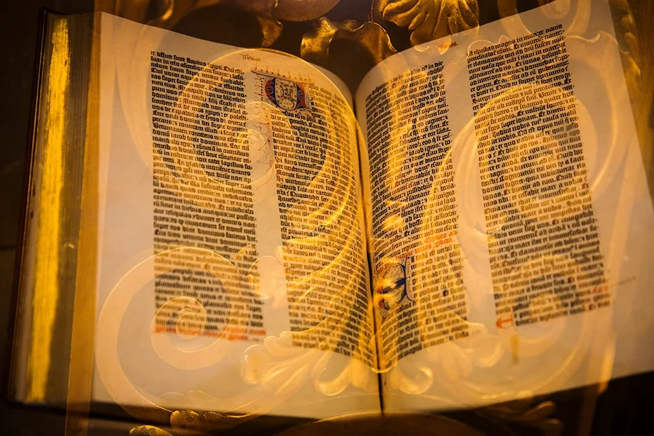 Ornate gilding enhances pages of the Gutenberg Bible on display in the Harry Elkins Widener Memorial Library.