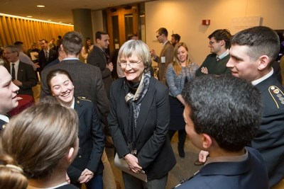 "At the Pusey Library exhibit ""To Serve Better Thy Country,"" President Drew Faust greets ROTC undergraduates. As Harvard's president, Faust has been instrumental in returning ROTC to the University."