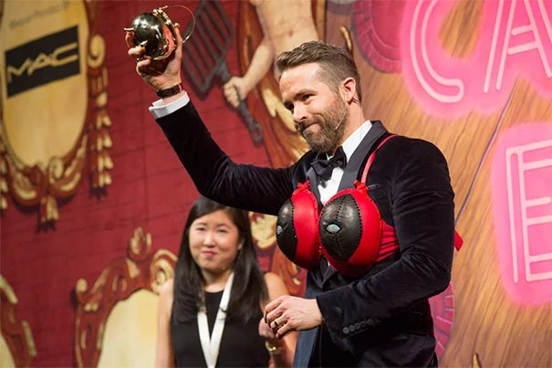 Hasty Pudding's Man of the Year Ryan Reynolds receives his pudding pot during the Friday night roast.