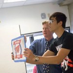 Albert Chien '19 (right) flies paper planes with John Collins, world record holder for flight distance of a paper airplane, during Collins' workshop that uses the surprisingly precise strategy of paper airplane folding to teach design engineering.
