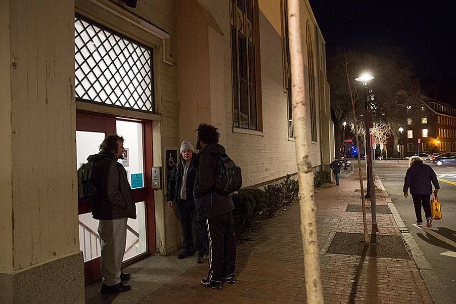 Guests outside 1 Church St. in Harvard Square wait for 7 p.m., when the Y2Y shelter opens and they can be admitted for dinner and the night. Guests can stay for up to 30 consecutive nights, then must re-enter a lottery for additional time.