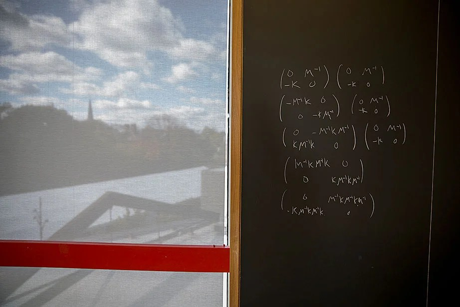 A math lounge blackboard sports writing dealing with a discrete dynamical system, part of linear algebra.