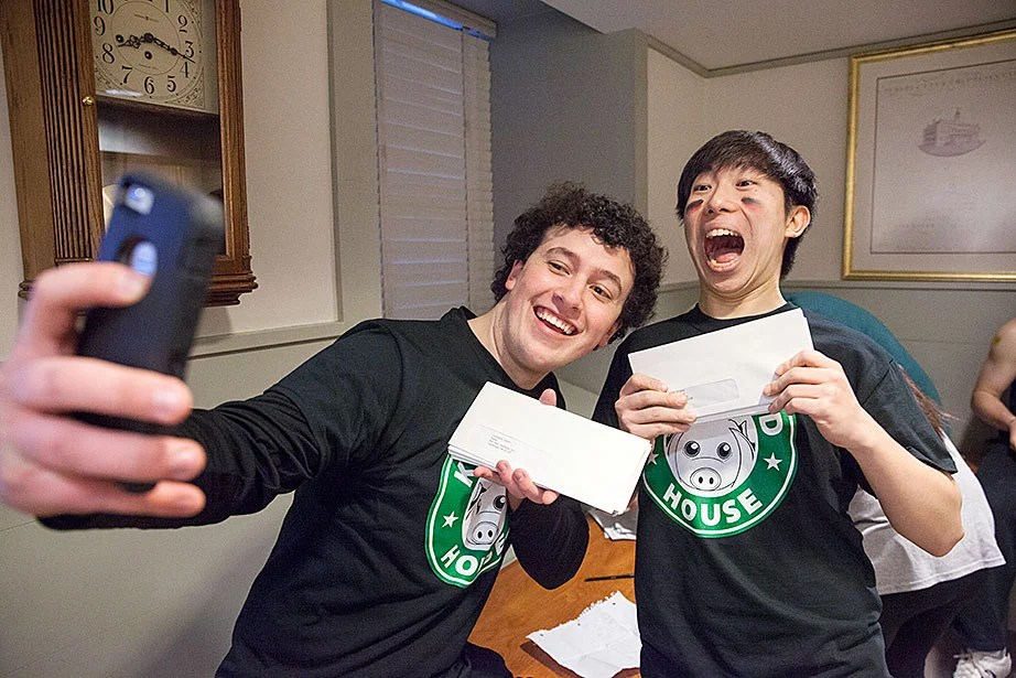 Kirkland House members Chris Dolliff '18 (left) and Hendong Park '18 take a selfie in University Hall before heading to the dorms with their letters for freshmen. Jon Chase/Harvard Staff Photographer