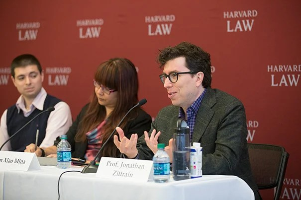 """At a panel discussion at the Berkman Klein Center on the pervasiveness of fake news, Jonathan Zittrain (right) said that people have lost faith in the credibility of the """"mainstream news"""" while the abundance of sources that cater to preconceived notions have made it """"hard to tell the reliable stuff from the nonreliable stuff."""" Fellow An Xiao Mina and MIT Ph.D. candidate Nathan Matias (left) listen on."""