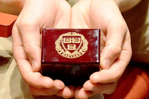 """Holding the box that his Harvard ring came in opened a flood of feelings for DeShaw. """"The 'one ring' ceremony was a rare chance to see a representation of my time at Harvard,"""" he said. Photo by Barbara DeShaw"""