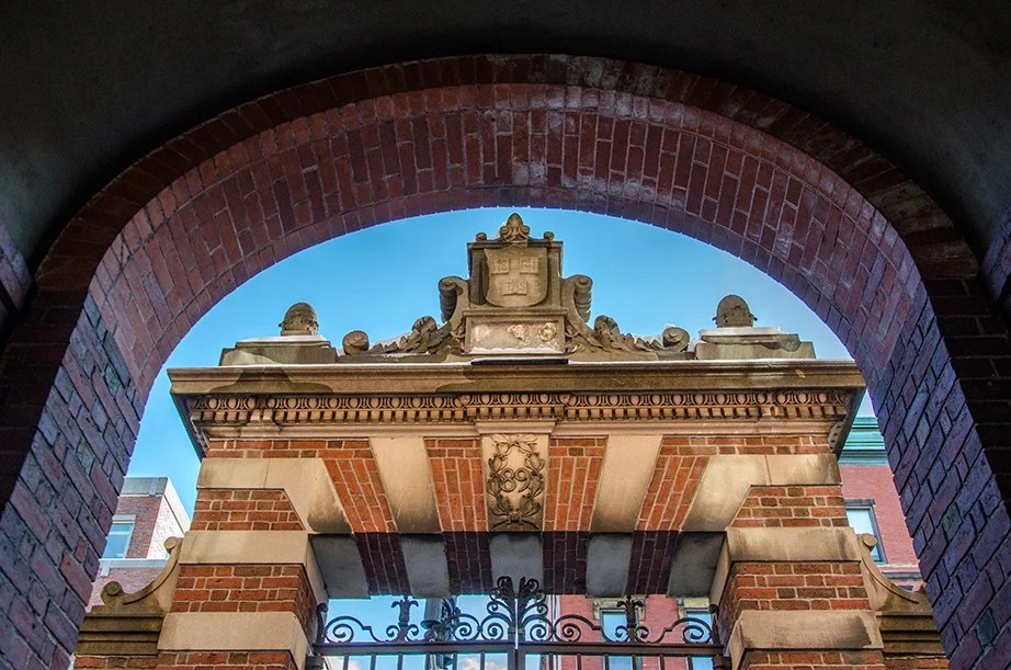 The Class of 1889 Gate, South, is crowned by the arched tunnel that crosses Wigglesworth Hall. This gate was planned as a twin to the Dexter Gate, but the latter's slight differences gave it more fame.