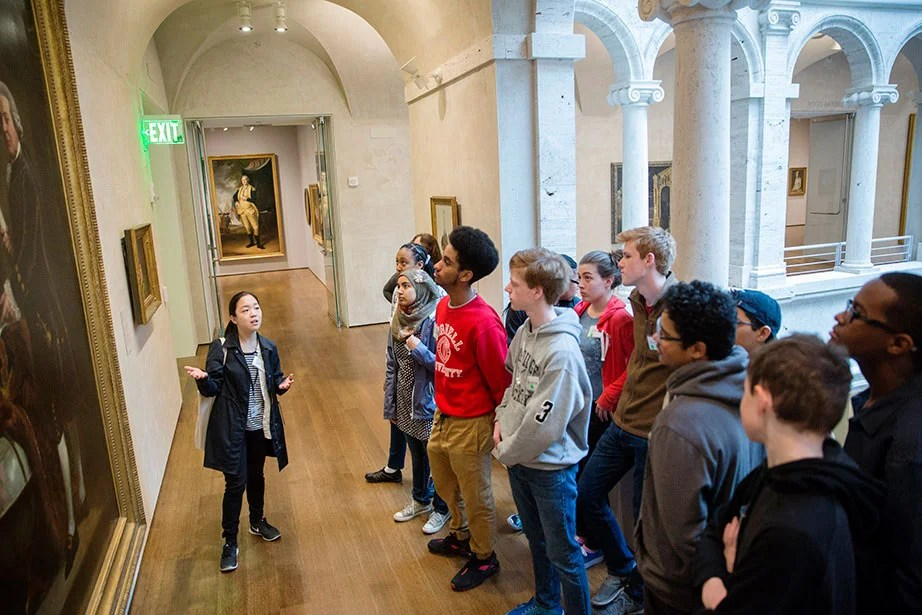 Jessica Paik (left), a graduate student teacher, engages in a lively discussion with Cambridge Rindge & Latin students visiting the Harvard Art Museums, which reopened after major renovations in 2014 in a state-of-the-art, light-filled building designed by architect Renzo Piano. In line with Harvard's commitment to sustainability, the museums' renovation and expansion achieved LEED Gold certification for incorporating a wide range of green building technologies including, energy-efficient LED bulbs and an innovative water conservation system. Kris Snibbe/Harvard Staff Photographer