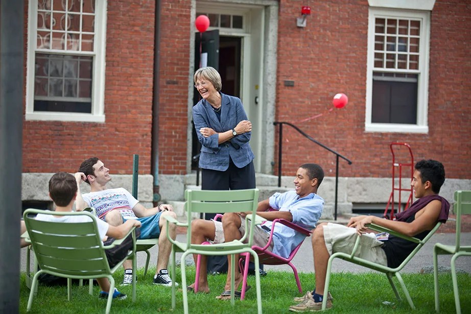 "As the class of 2015 moves into Harvard Yard, President Faust speaks with students in the colorful Luxembourg Chairs. The chairs are a key component of Faust's Common Spaces initiative, which she called ""an effort to create new spaces that will draw our increasingly diverse and interdisciplinary community together and enhance the intellectual, social, and cultural life that is at the core of the Harvard experience."" Photo by Justin Ide"