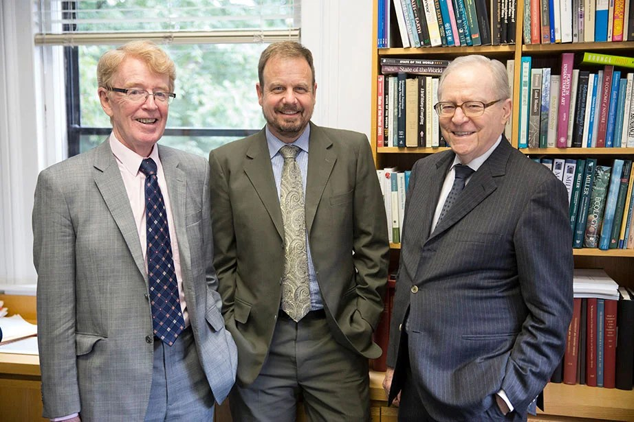A multidisciplinary, collaborative project to investigate climate change, energy security, and sustainable development in China receives the first $3.75 million grant from the new Harvard Global Institute (HGI) in October 2015. The project will be headed by economist Dale Jorgenson (right), atmospheric scientist Michael McElroy (left), and Chris Nielsen. The HGI was launched by President Faust to support research initiatives that deepen Harvard's international engagement and promote University-wide scholarship to address pressing global challenges. Kris Snibbe/Harvard Staff Photographer