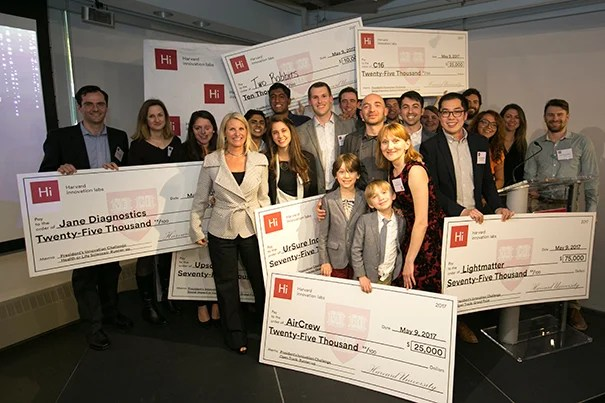 Jodi Goldstein (white jacket), managing director of the Harvard Innovation Labs, poses with all of the 2017 President's Innovation Challenge winners.