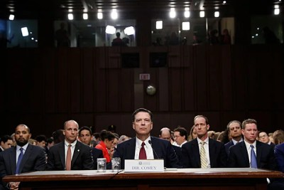 Former FBI Director James Comey listens to opening remarks at Thursday's  Senate Intelligence Committee hearing.