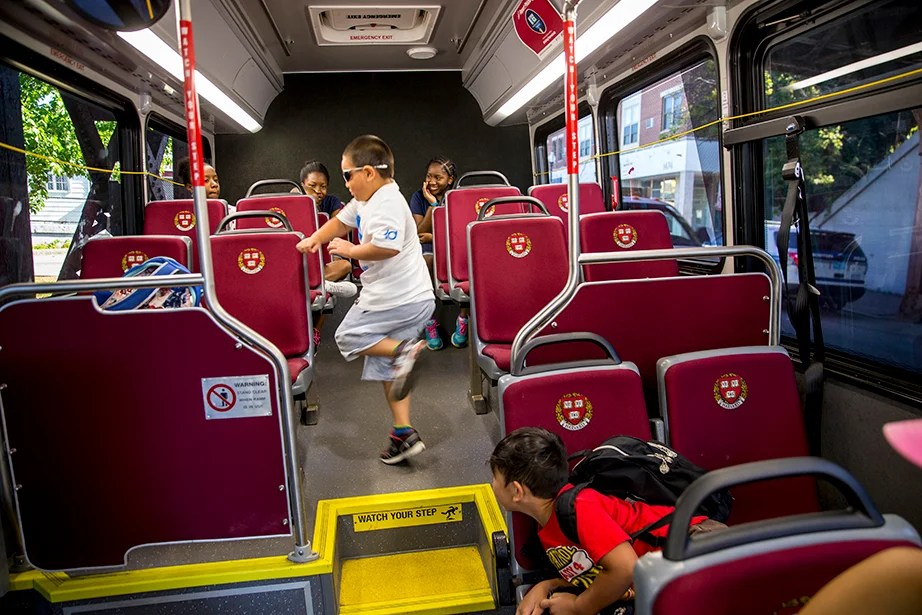 Willy Nguyen, 6, dances in the aisle.