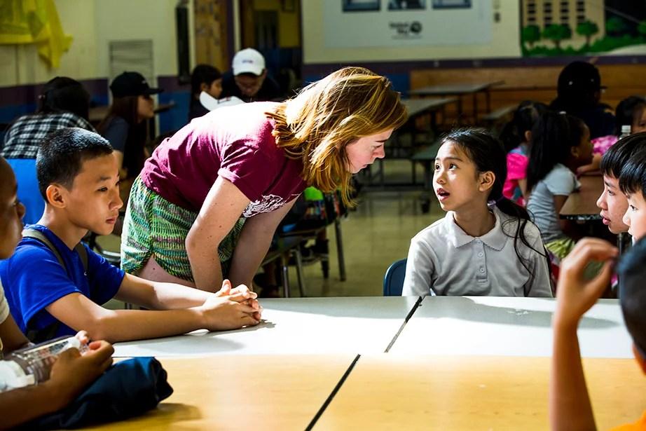 BRYE director Sophie Eakins, a Wellesley student, greets camper Thanh Nguyen.