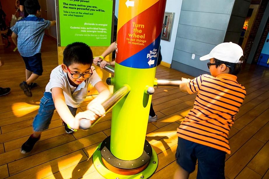 Khang Vu (left) and Nhon Nguyen work together on an interactive exhibit.