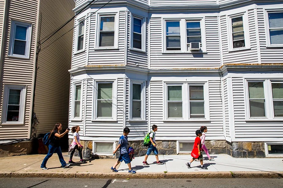 """Rebecca Hernandez '19 guides campers back to Murphy School. Hernandez said it was on a field trip to Georges Island that she realized her group had united. """"On Day 1, I didn't think it would happen, and it did,"""" said the Texas native who moved to the U.S. from Mexico at age 6. She recalled that her childhood summers at camp helped her advance at school. She hopes to teach high school when she graduates from Harvard."""