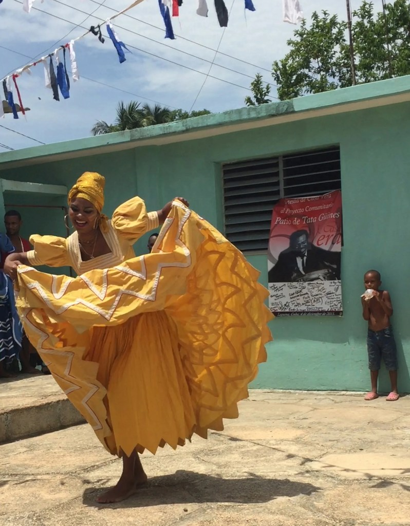 A member of the National Folkloric Company of Cuba dances in the Tata Güines museum courtyard.