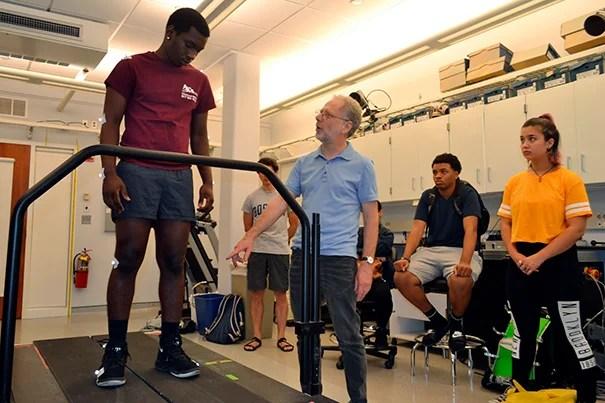 Cambridge-Harvard Summer Academy student Simão Silva (left) gets running tips from Harvard Professor Daniel Lieberman.