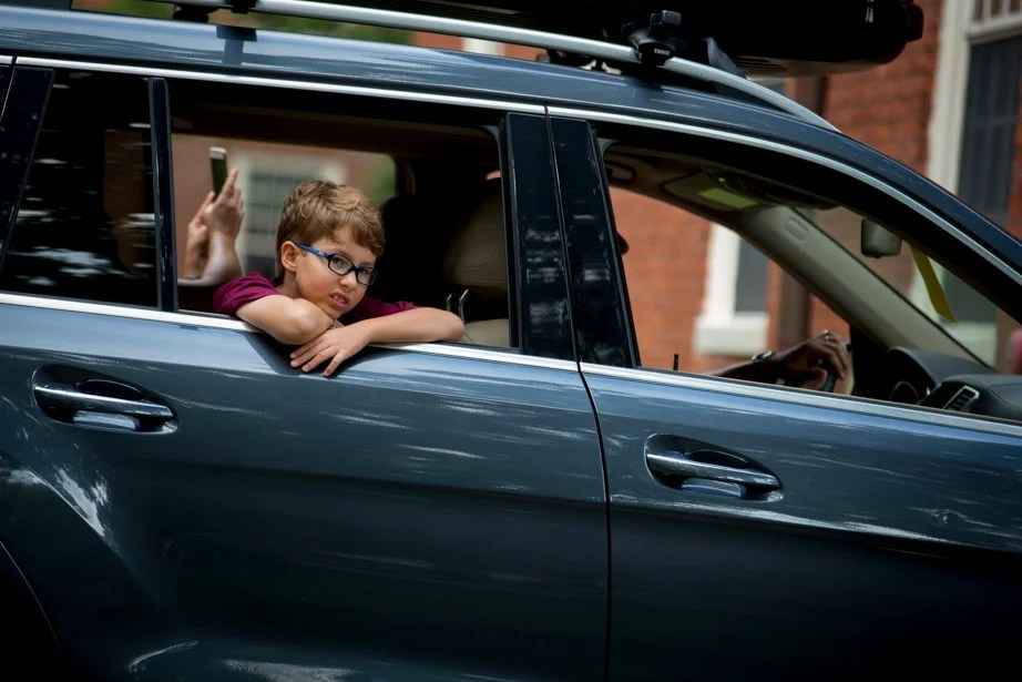 Eight-year-old Tomas Young pulls into Harvard Yard in the family car with his brother, incoming freshman Fernando Young. Rose Lincoln/Harvard Staff Photographer